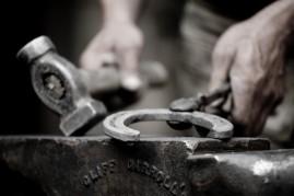 Blacksmith shaping a horseshoe